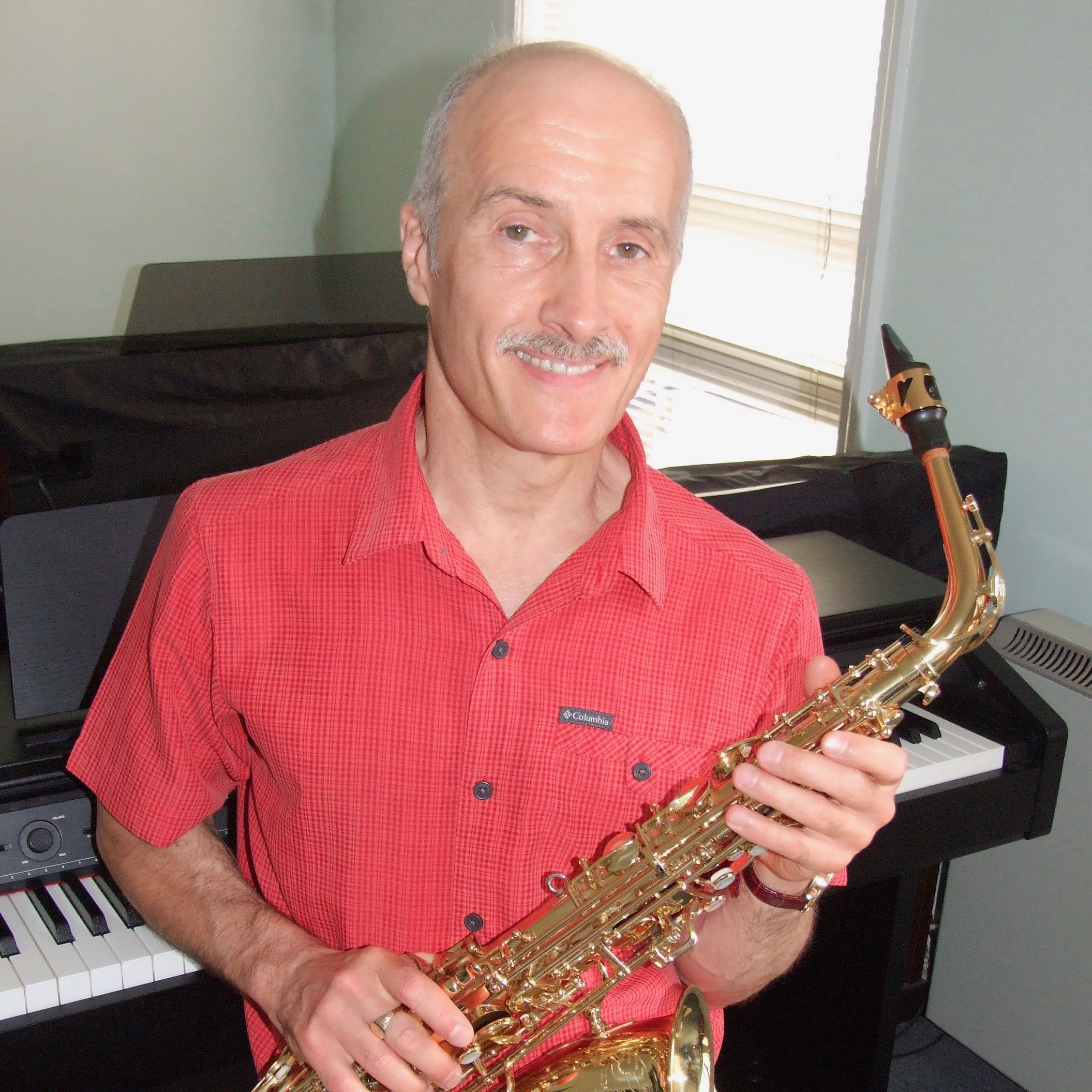 Darrell Priestley with saxophone